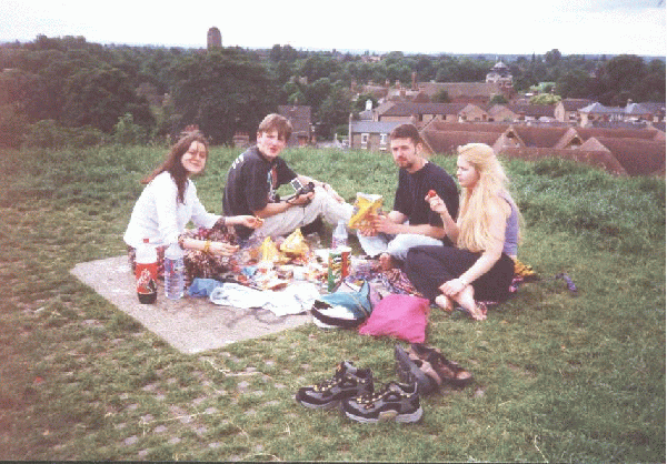 Skye, Chris, Anselm and Helen - eating atop Castle Hill